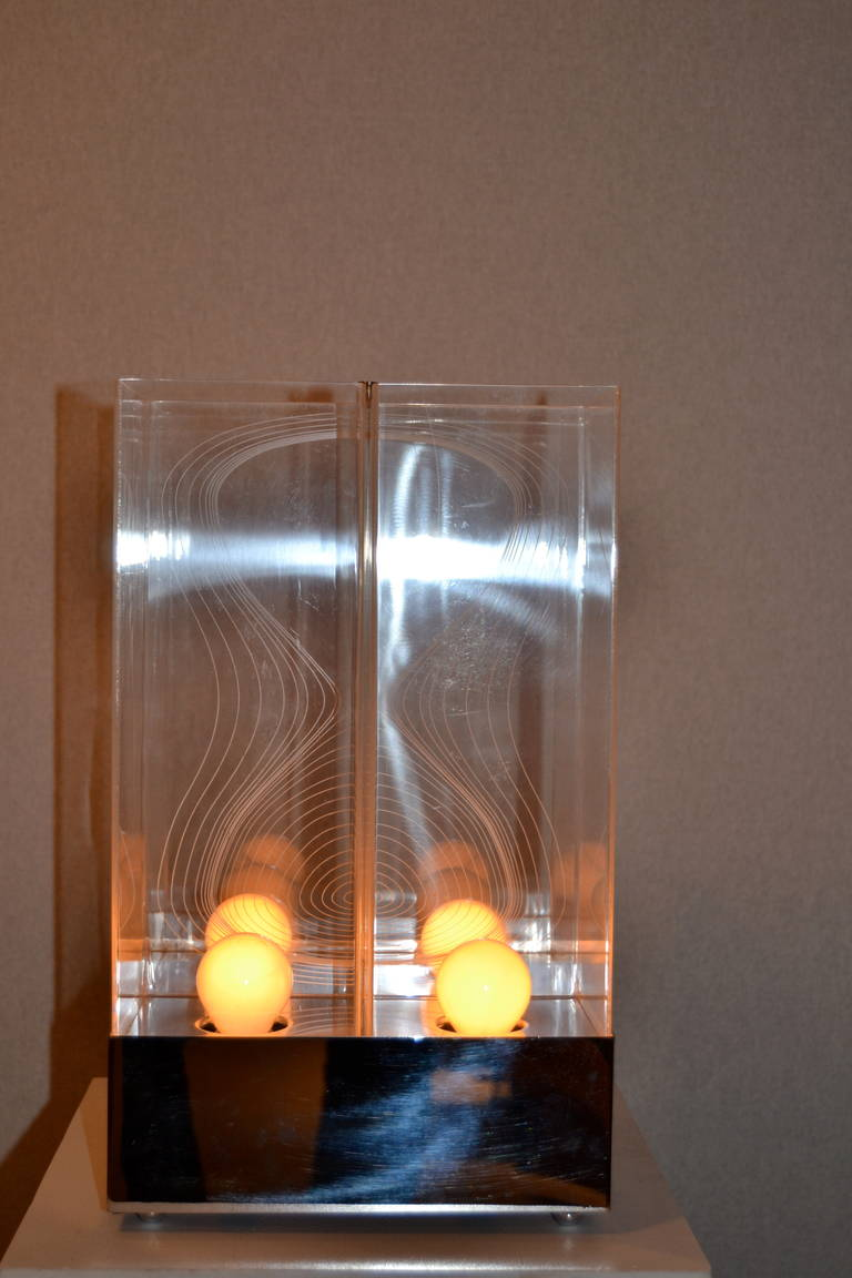1970s Kinetic Lucite engraved lamp with chromed steel base. Designed by Salvadori & Bazzini for Sormani, Arditi, Italy.  Great condition.