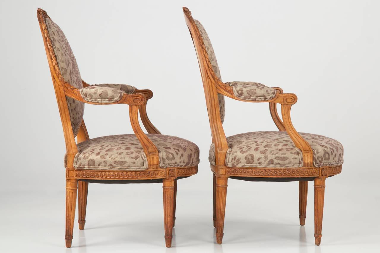Pair of French Louis XVI Style Carved Antique Arm Chairs