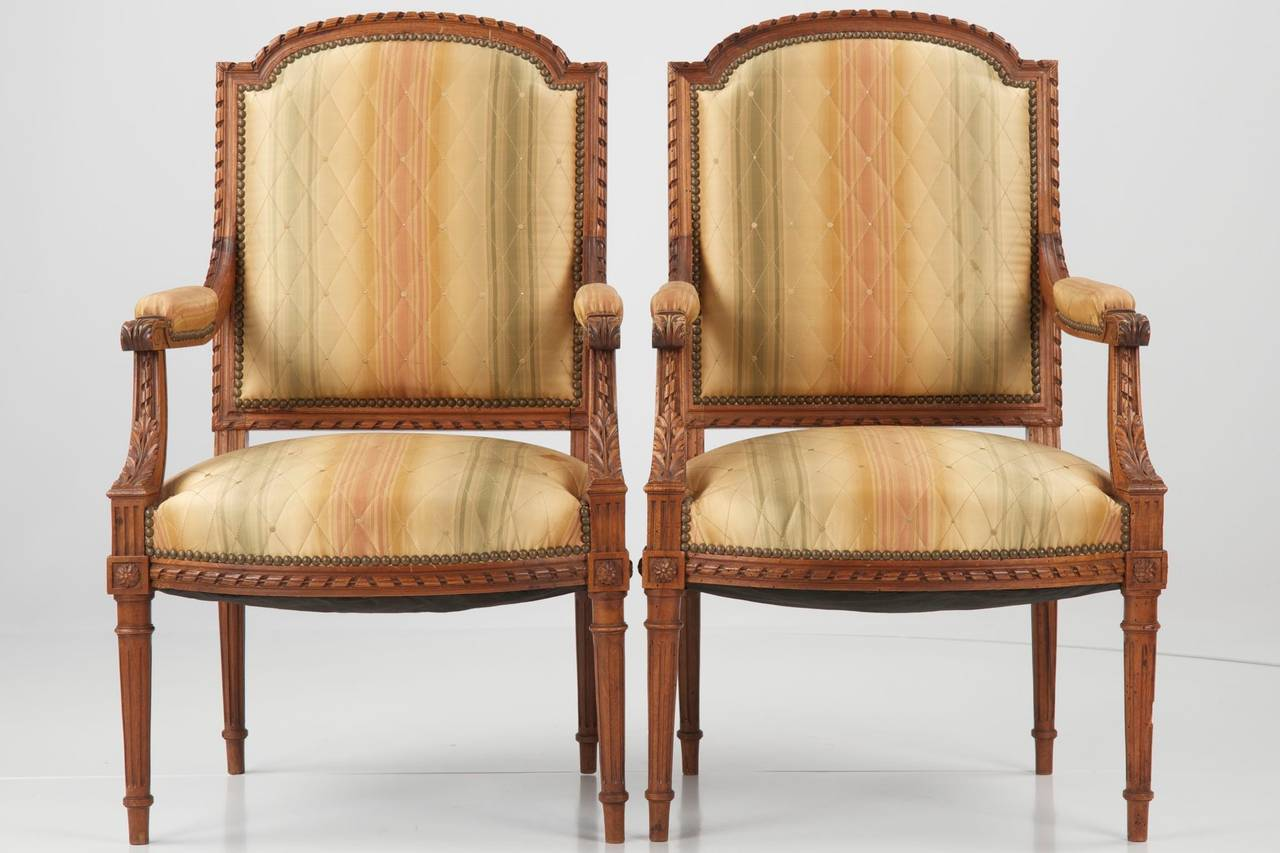 pair of french louis xvi style antique walnut armchair fauteuils