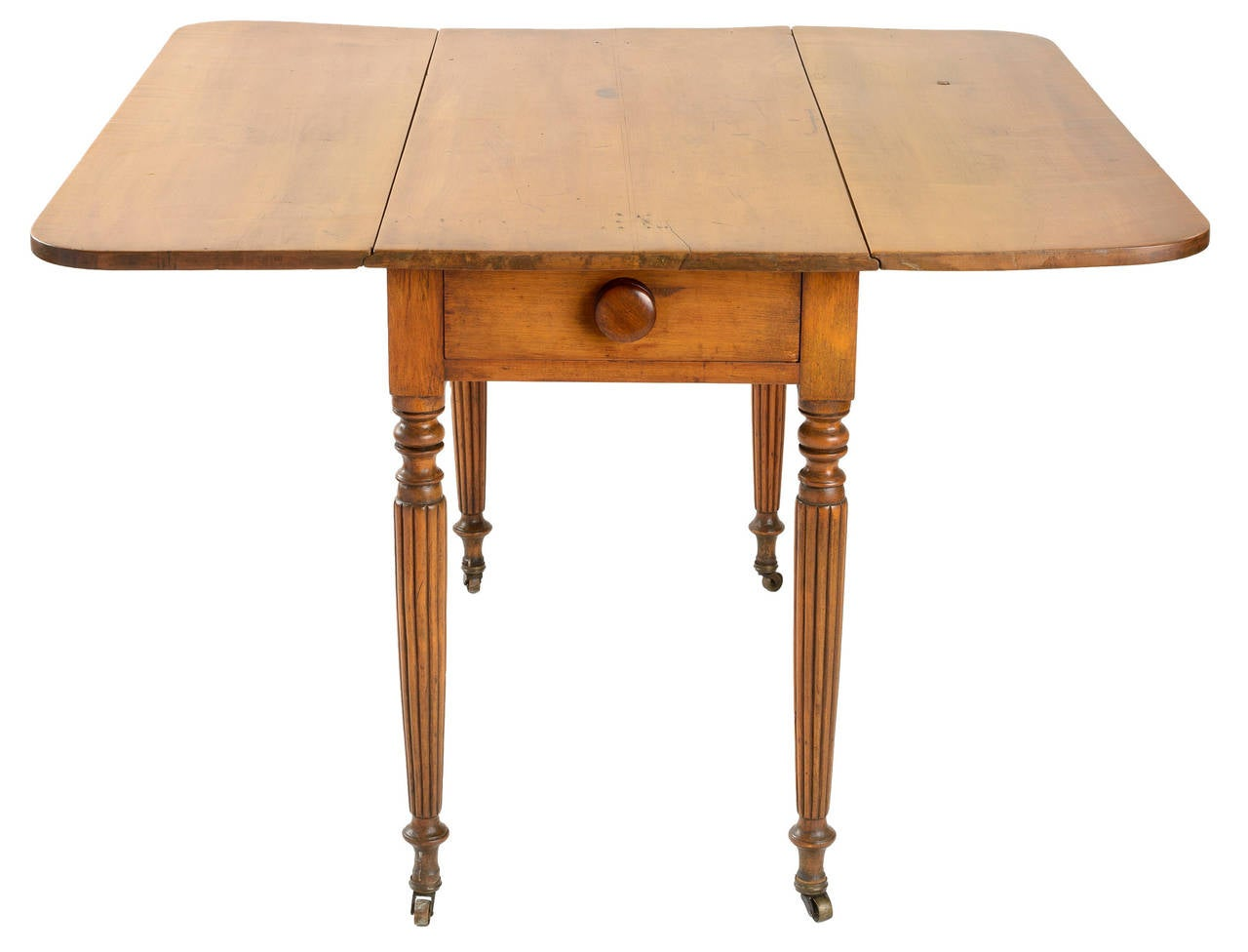 American country Sheraton pine gate leg table with two drop leaves. The top and leaves are one board each. The reeded legs are delicately tapered and have original brass casters. The drawer is dovetailed and has the original turned knob. The table's