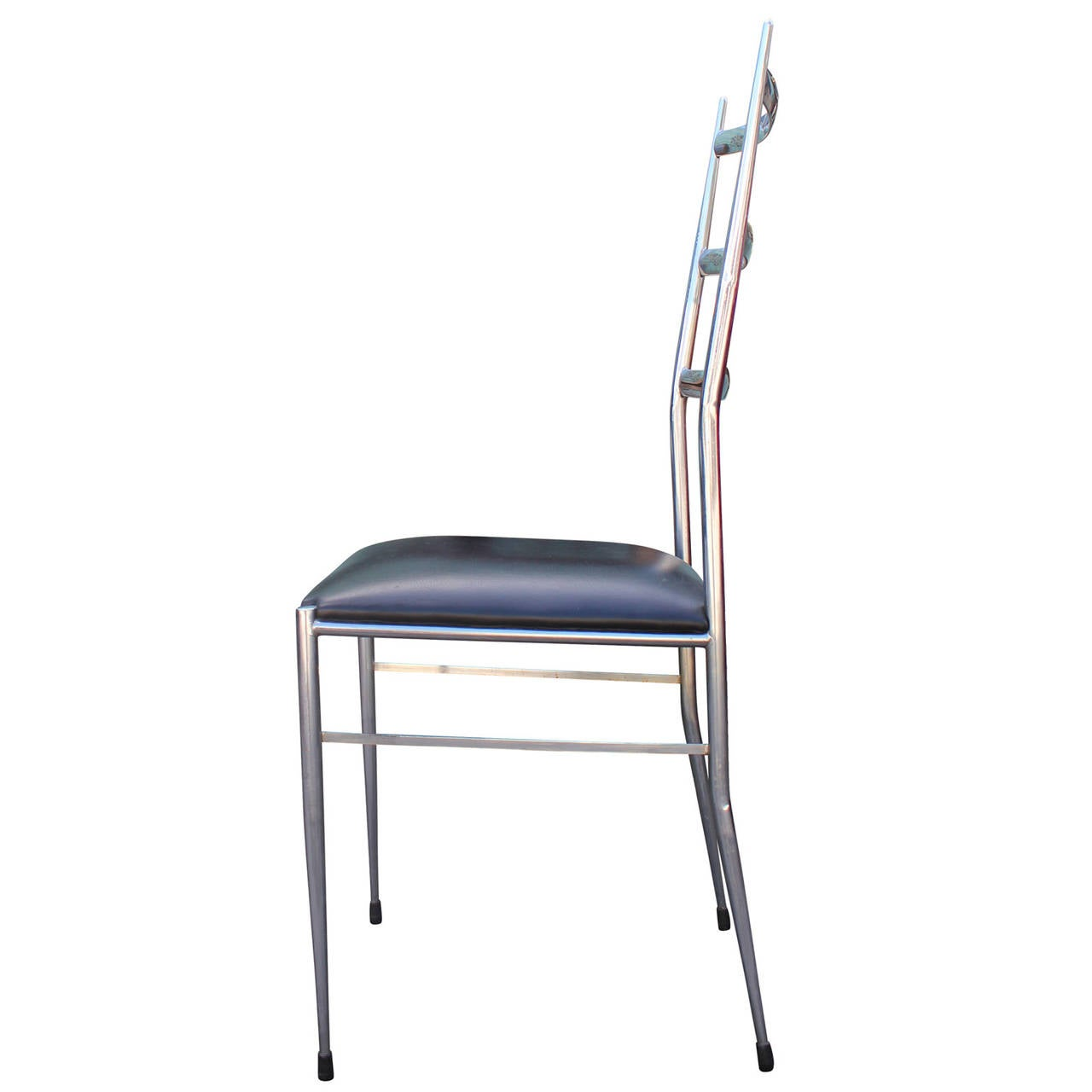 set of four modern chrome ladder back dining chairs in the style of