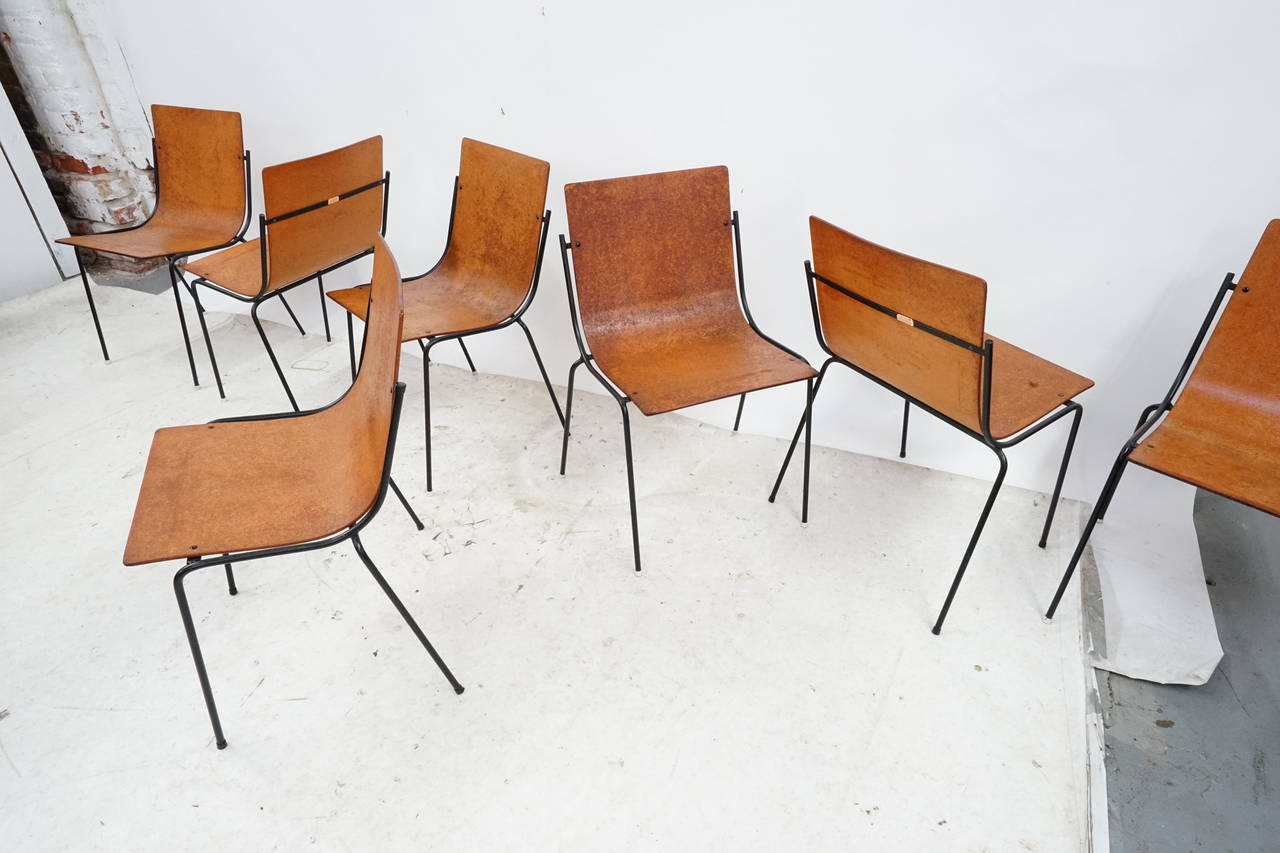 12 modernist iron dining chairs in the manner of charlotte