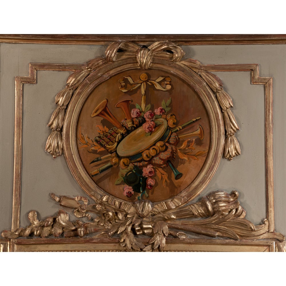 Antique Louis XVI painted and gilded trumeau mirror with a trompe l'oeil painting above the mirror, circa 1880.