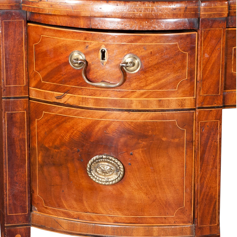 Inlaid Sheraton mahogany sideboard with brass gallery, string satinwood inlay on square tapered legs with spade feet. Brass gallery fully attached with no weakness. All parts original, circa 1790.