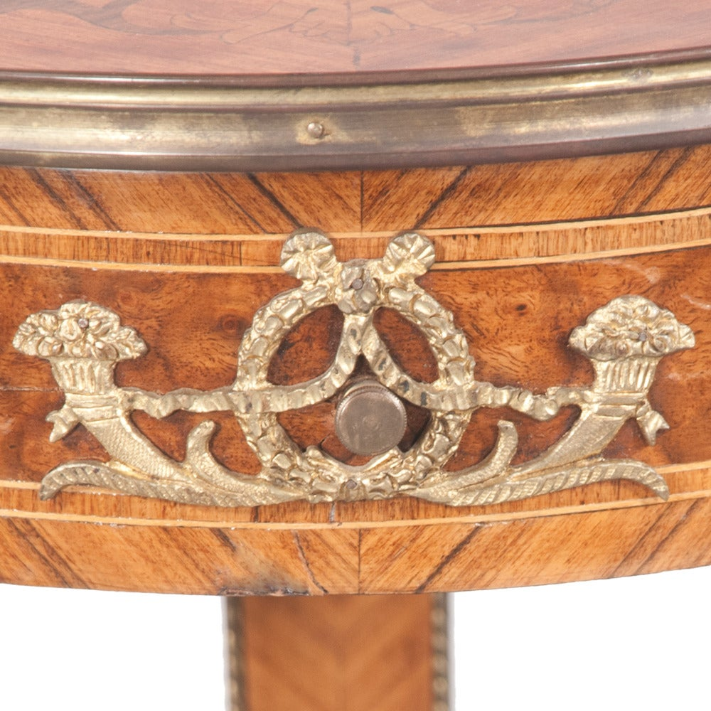 Pair of bronze mounted walnut Empire style pedestals with marquetry inlaid tops and on square tapered legs. Pedestals feature intricate carvings as well as original antique brass onlays.