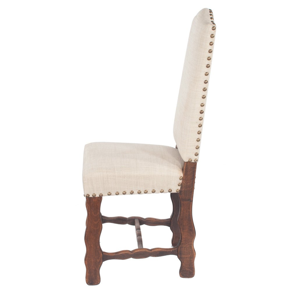 Set of six Country French dining chairs with sheepbone stretchers...linen upholstery in very good condition in a light neutral...adorned with large antique brass nailheads. Seat height on these chairs is 19.5