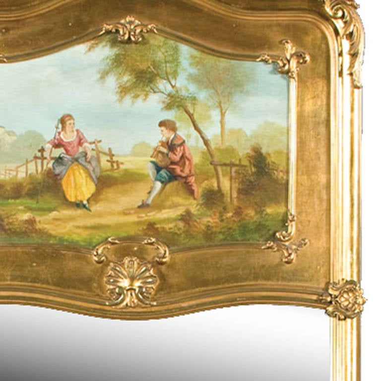 Louis XV gilded trumeau mirror with hand-carved onlay, as well as the classic oil painting above, featuring a couple in a garden scene. Excellent condition.