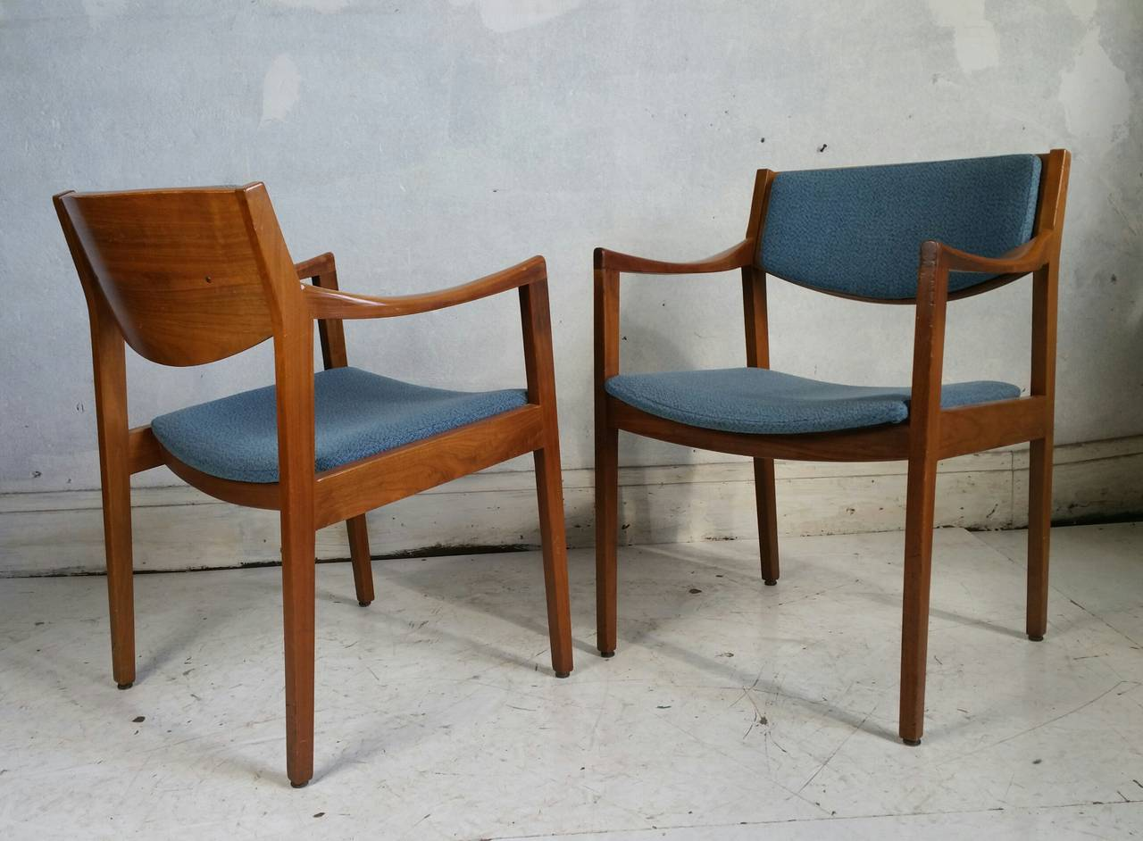 Pair of mid century modern gunlock arm chairs in the jens risom style
