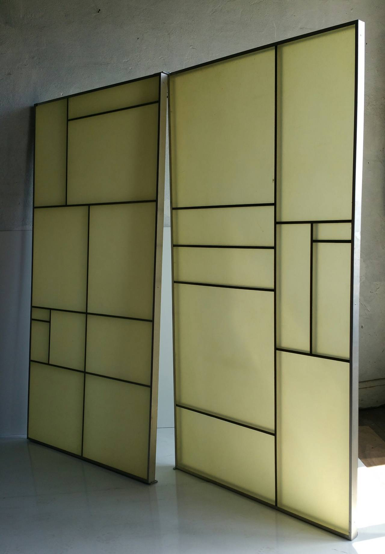 Very unusual aluminum and fiberglass panels, amazing Piet Mondrian design. Double sided. Retain aluminum mounting bracket affixed to top and bottom. Make a wonderful privacy screen, room divider, back lit décor.