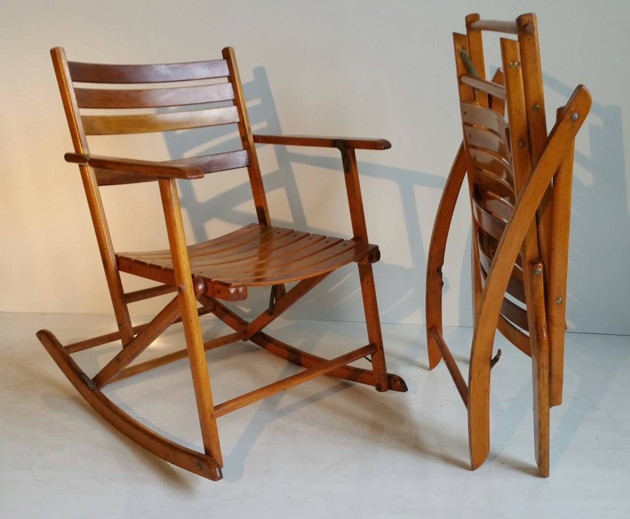 Pair of modernist folding slatted rocking chairs by for Rocking chair