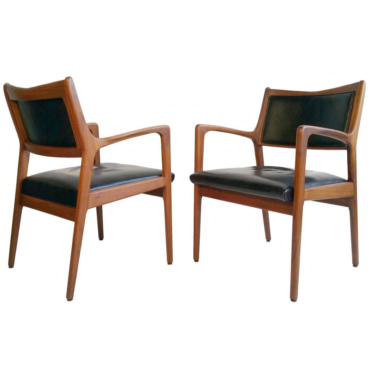 Matched pair of walnut and leather arm chairs mid century for Mid century modern leather chairs