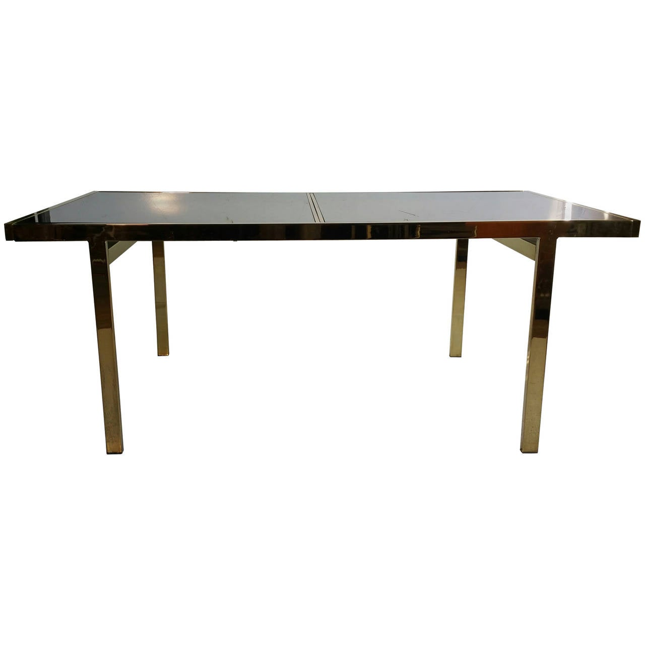 this expandable mastercraft brass and smoked mirror dining table