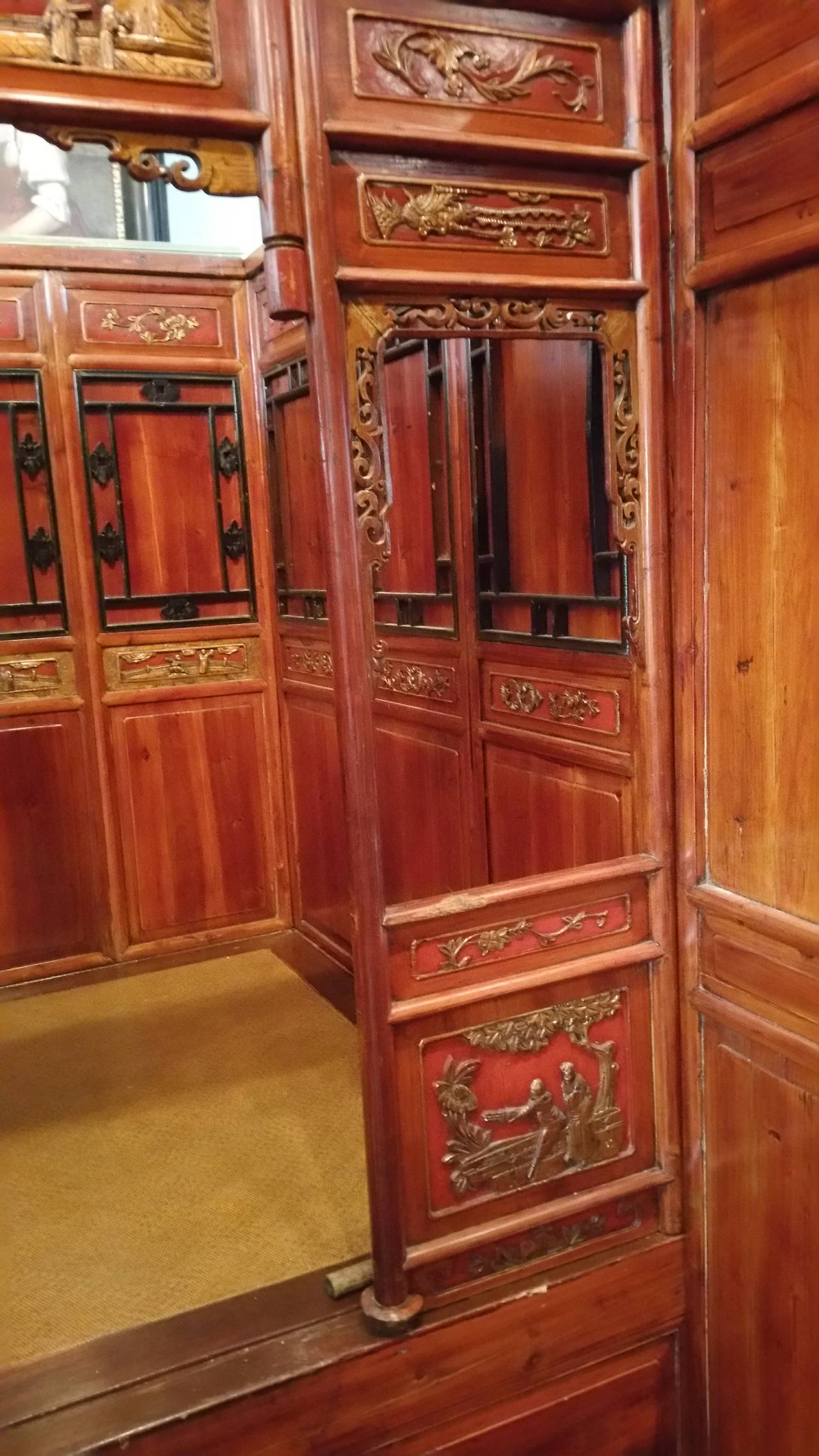Mid to late 19th century, elaborately carved, antique Chinese bed Chambers was used to greet visitors and usually was furnished with two chairs and a center table: from which tea, wine and food were served. The front alcove section of the bed
