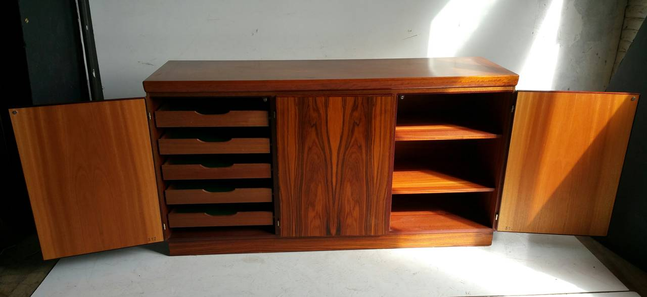 Classic Figured Rosewood Cabinet or Server,made by Skovby Mobelfabrik,Denmark, Sleek ,simple design..Wonderful bookmatched rosewood doors, Left door covering five lined silverware drawers.Right two doors over two generous size shelves.Great
