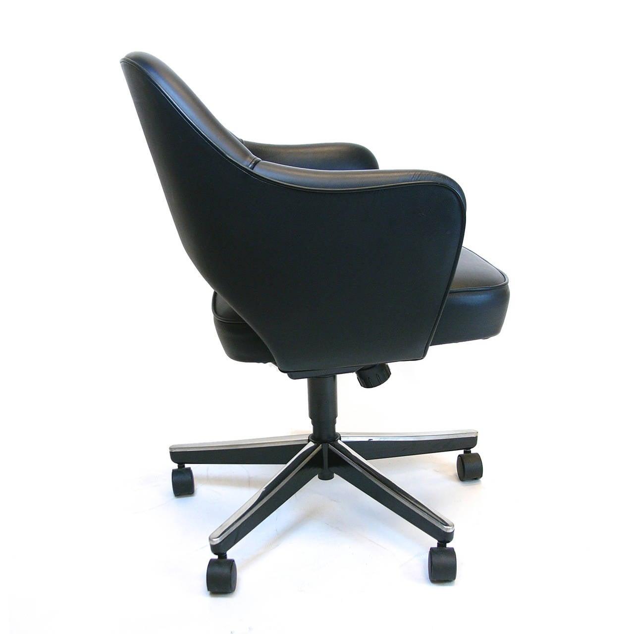 pair of eero saarinen executive swivel armchairs for knoll in  - pair of eero saarinen executive swivel armchairs for knoll in black leather
