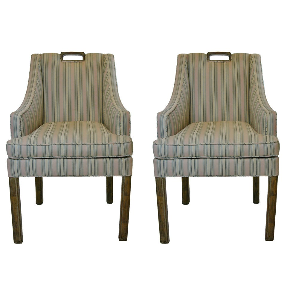 A pair of rare James Mont dining or occasional chairs in original distressed gold leaf finish. The seat height is 19 inch. 16 wide and 16 3/4 deep.