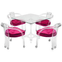 Chic Set of Four Hot Pink Lucite Chairs and Matching Table