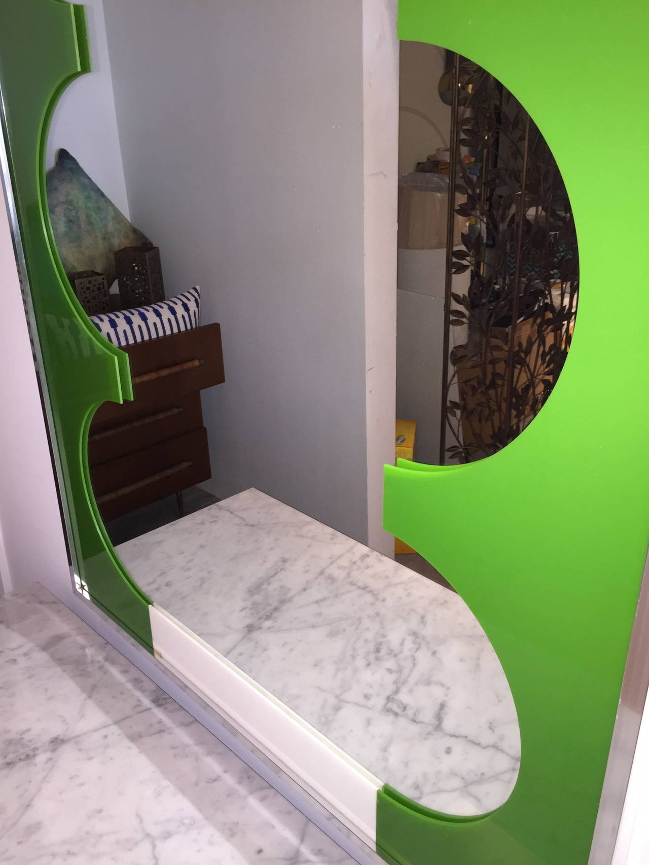 So very groovy baby! Vintage chartreuse plastic mod op art mirror would be a fun addition to a powder room or any bedroom.