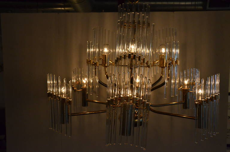 Gaetano Sciolari lived and designed chandeliers in Italy. His pieces combined minimalism with high-glamour. His designs are comprised of shapes arranged in a geometric yet surprisingly organic pattern. His creations are highly reflective and