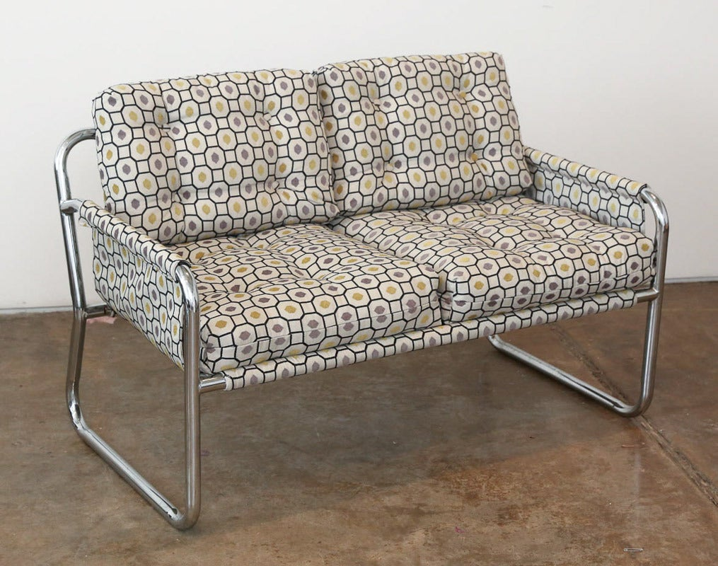 """This """"Jefferson Airplane"""" honeycomb upholstered Zermatt chrome tubular sling-back settee is attributed to Duncan Burke & Gunter Eberle for Veeta Group, Italy. White rabbit not included! This ever-so comfy two-seat has a """"fraternal twin,"""" the """"Zany"""""""