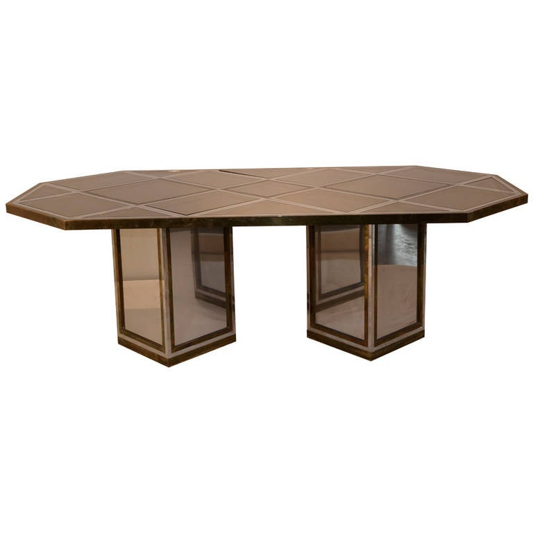 Offered are a Mid-Century Modern Italian Romeo Rega brass, chrome and mirror harlequin style dining table and/or desk. Italian elegance in chrome, brass and cut glass mirror. Each piece of cut glass mirror fits into a specific spot and is labeled.