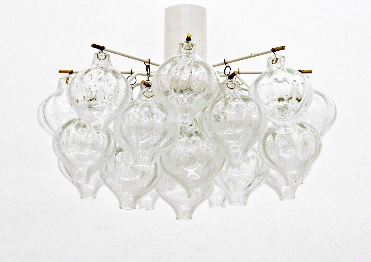Beautiful ceiling mount by J.T. Kalmar with 24 glass elements. Lit by a single large bulb they cast a delicate light and shadow play onto the surrounding walls.