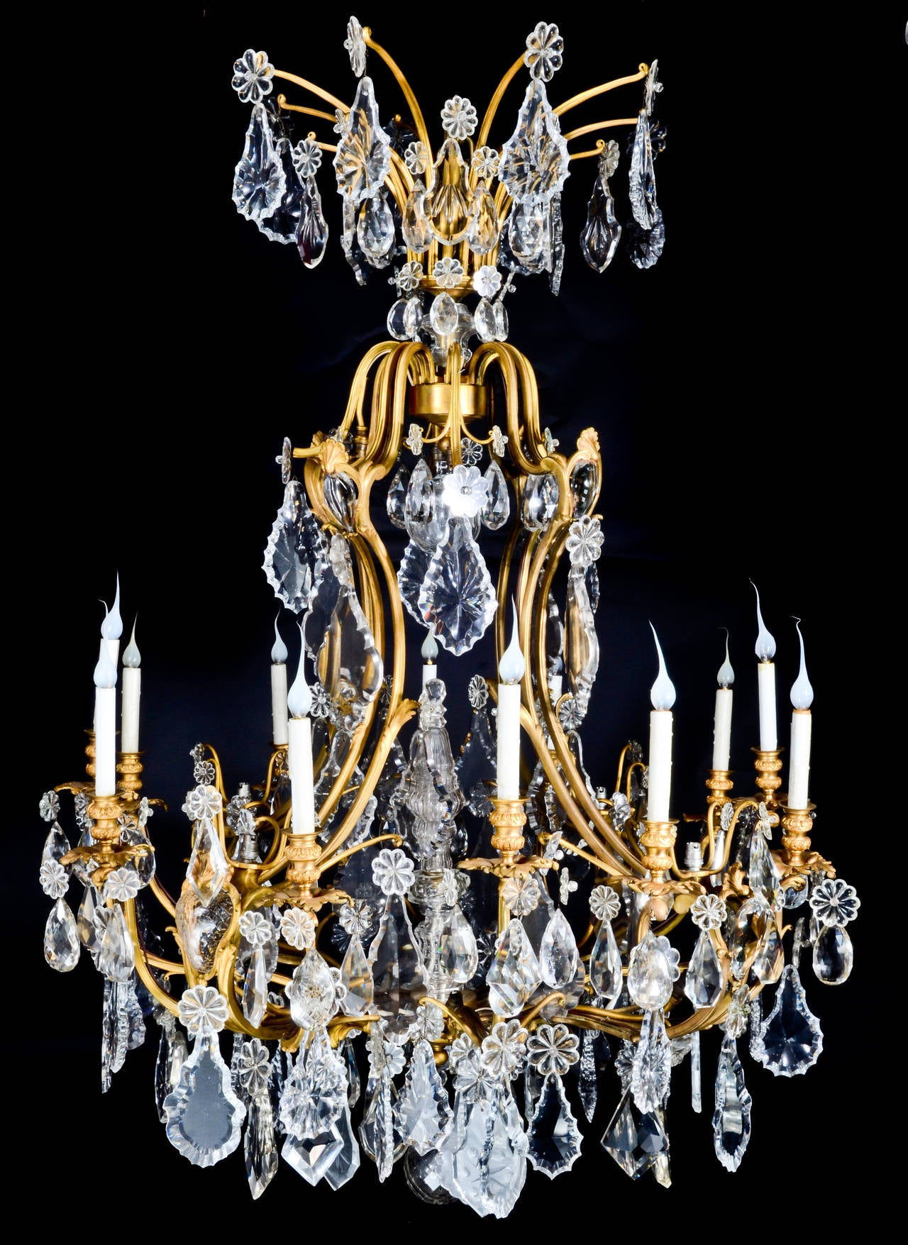 A Large Antique French Louis XVI Style Gilt Bronze & cut crystal cage form multi light chandelier of great quality embellished with large cut crystal prisms, 19th century.