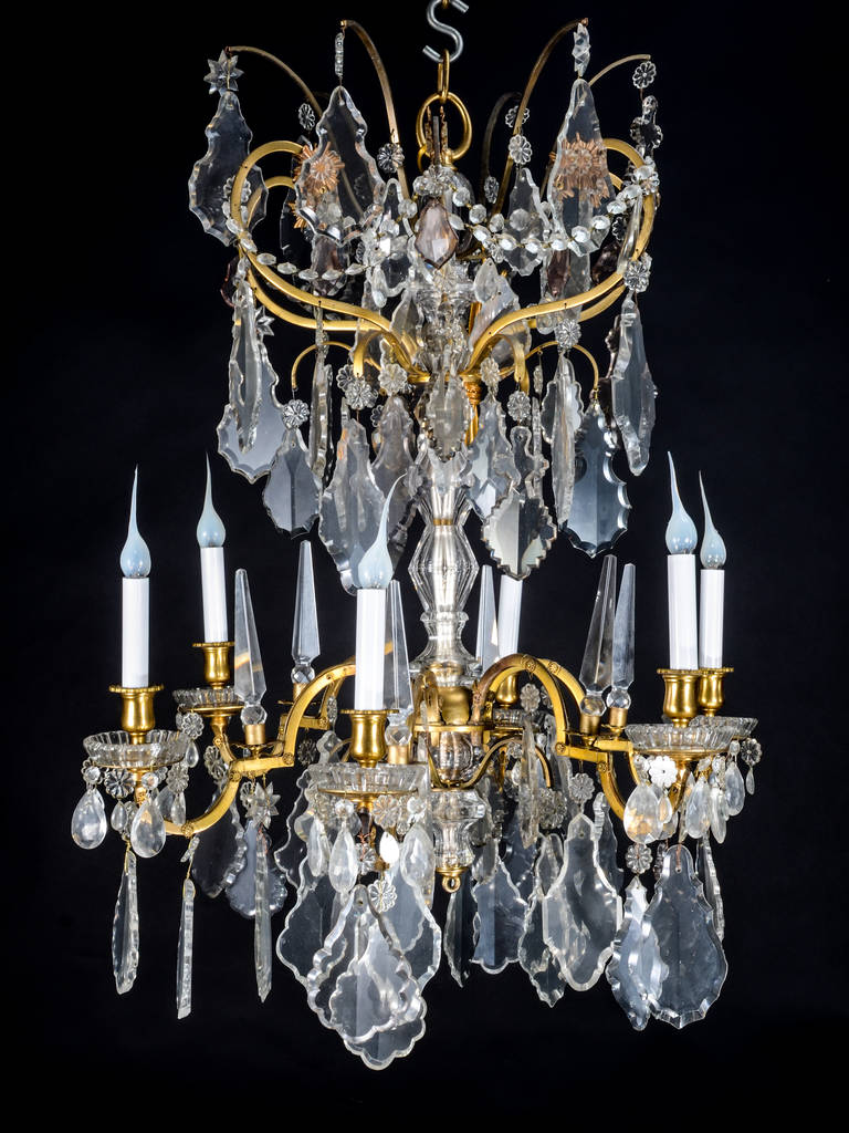 A fine antique Baccarat Louis XVI style gilt bronze and cut crystal  chandelier embellished with glass - Fine Antique Baccarat Louis XVI Style Gilt Bronze And Cut Crystal