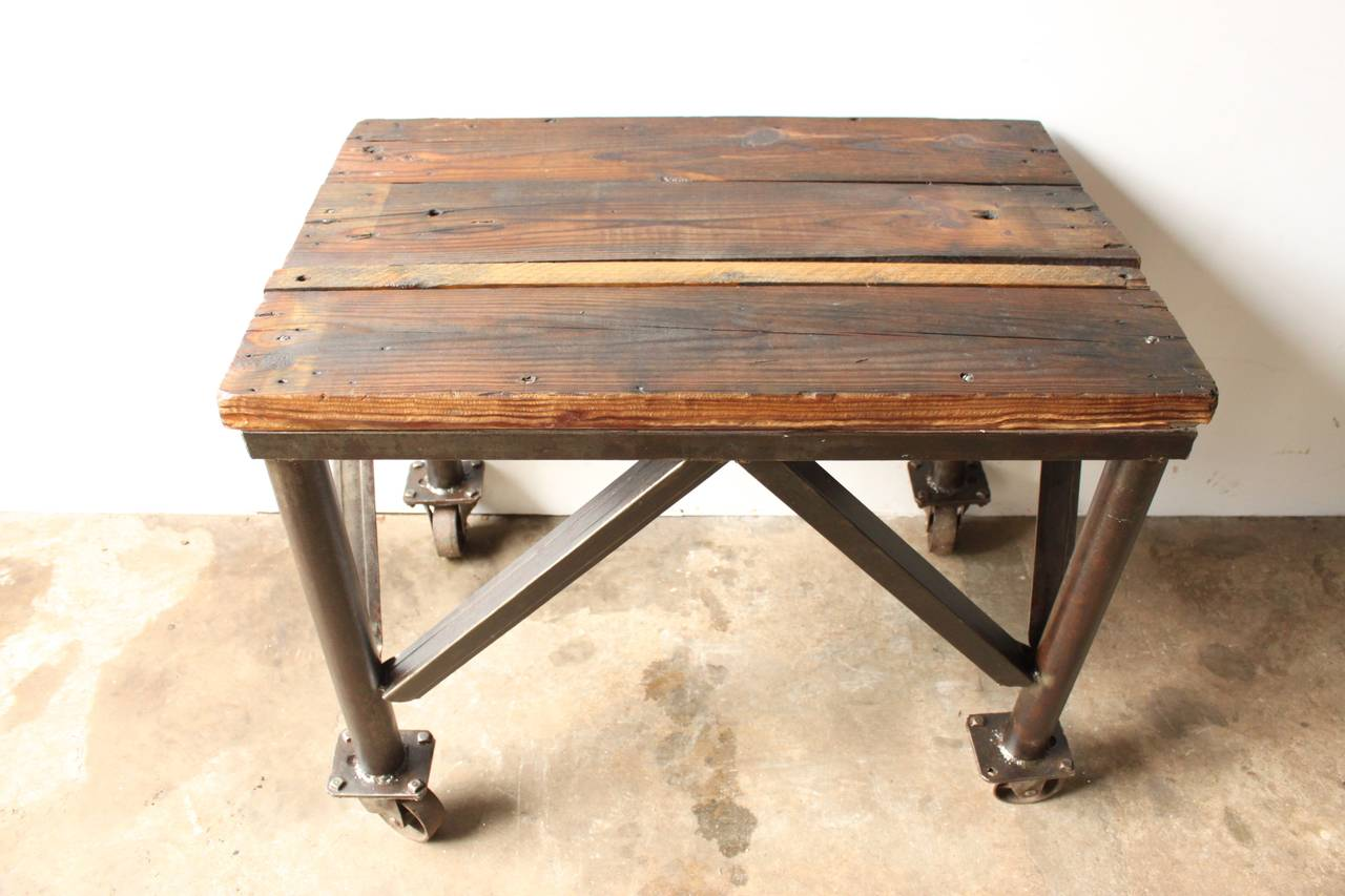 Iron and wood rolling table at stdibs