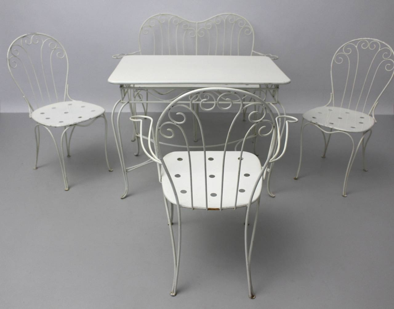 Very elegant vintage seating group designed and executed by Stanislaus Karasek and Co, 1950s, Vienna, Austria. The seating group is usable for indoor and outdoor.  This charming garden seating set from the 1950s consists of one bench, one armchair,