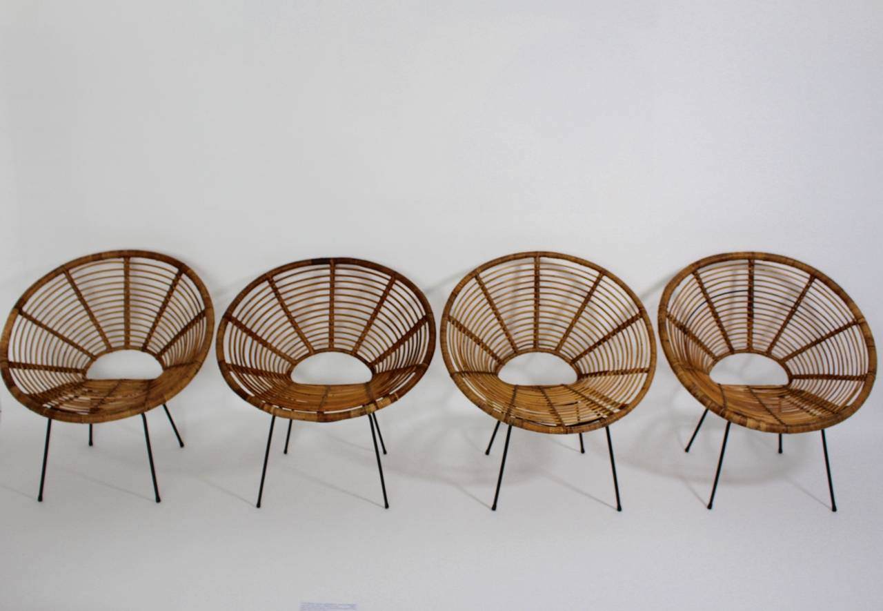 Mid-20th Century Mid Century Modern Rattan Vintage Chairs France 1950s Set of four Rattan Metal For Sale