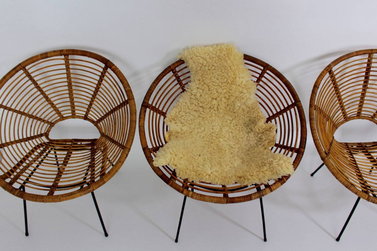 French Mid Century Modern Rattan Vintage Chairs France 1950s Set of four Rattan Metal For Sale