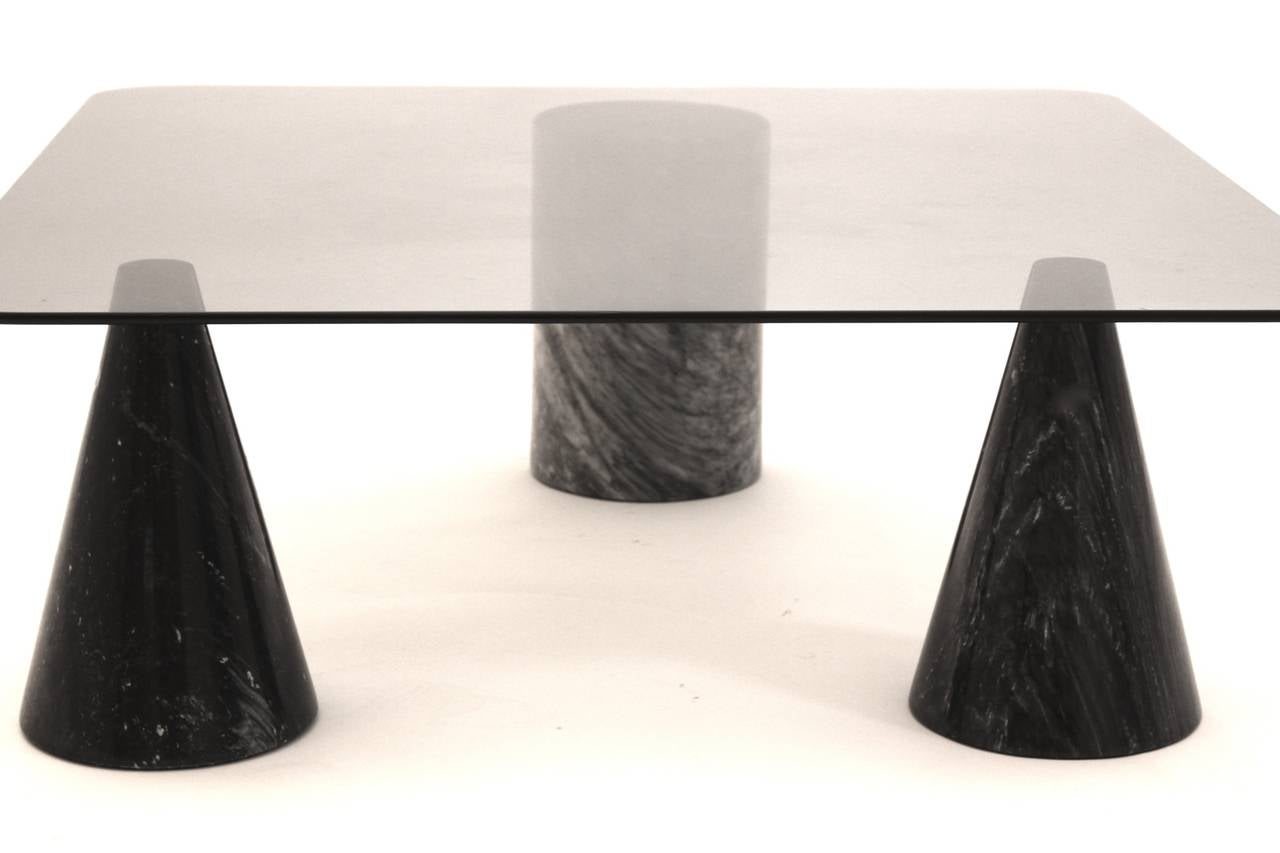 Three geometric grey marble elements topped with a smoked glass top.