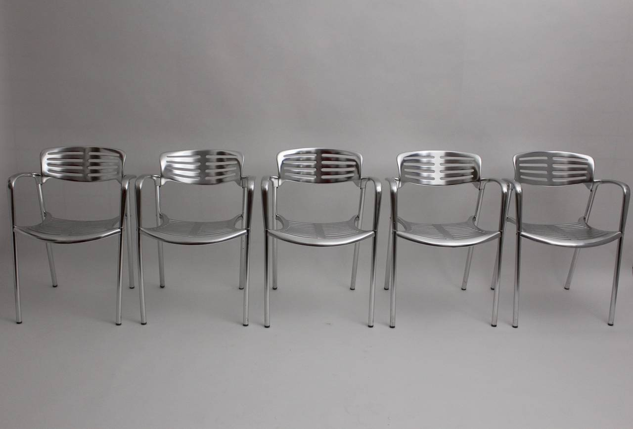 Set of five aluminium stacking chairs designed by Jorge Pensi, 1986-1988, and produced by Amat-3. Provide with the stamp