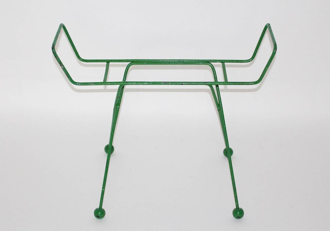 This presented Luggage rack is attributed to Jean Royère, 1950s.  This rack was made of green lacquered steel with four wooden balls at the end of the legs. The wooden balls are also green lacquered. The luggage rack table is in very good vintage