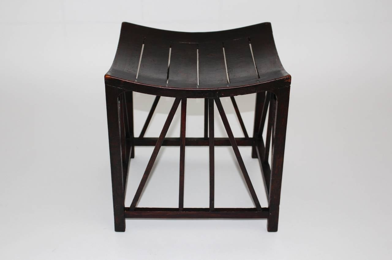 This stool is made of solid oakwood and was made 1910 by Liberty & Co, UK.  An earlier model of our stool is exhibited in the British Museum in London and was designed and manufactured circa 1400 before Christ.  Our Thebes stool is in original