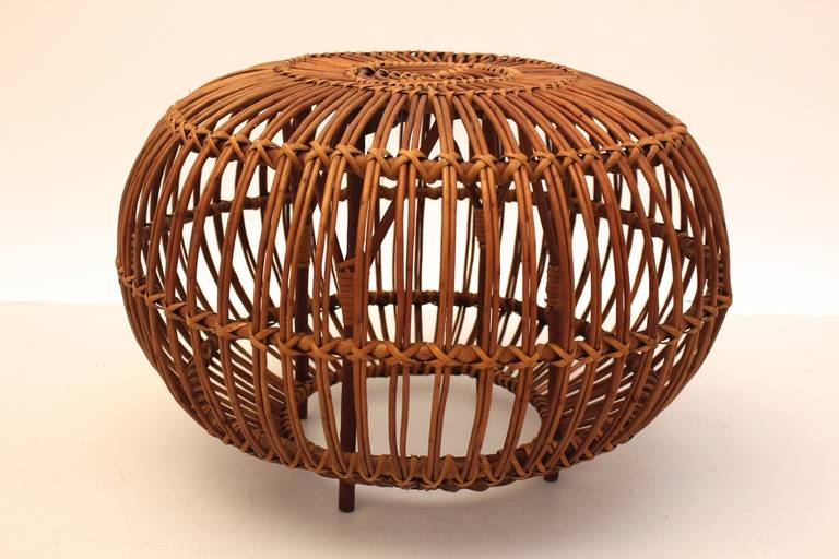 A mid century modern vintage rattan pouf or stool, which was designed attributed to Franco Albini. Italy 1950s.  The rattan pouf is very stable, although it looks like lightweight. Furthermore it shows very good vintage condition, no losses or