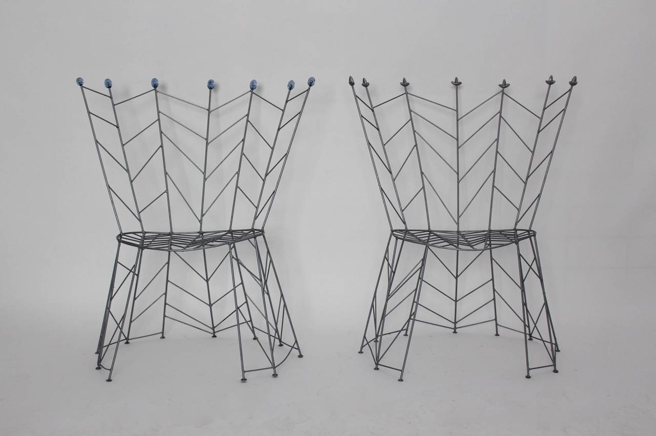 A sculptural and fairy-tale design and sitting comfort. This combination shows this pair of modernist metal vintage chairs, named Pupeny (Buds) designed by Bohuslav Horak, born 1954. He worked with the artistic group Atika (1987-1992).   He