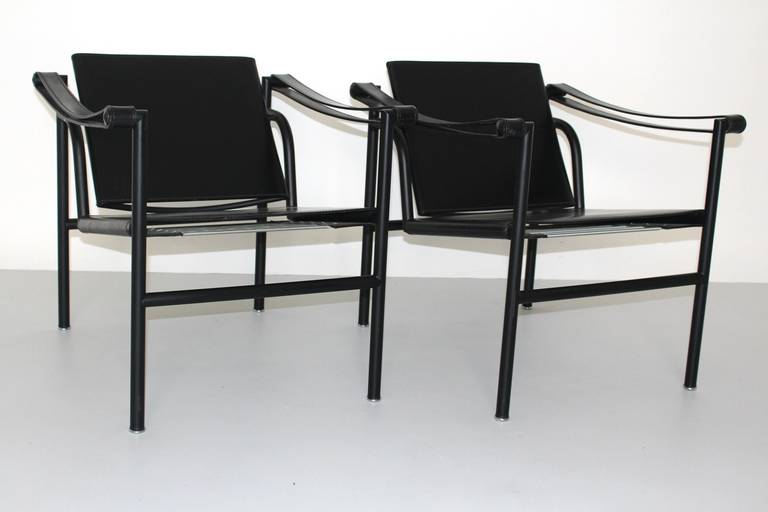 Black lacquered tabular steel, black leather seat and backrest, widened leather arm slings.