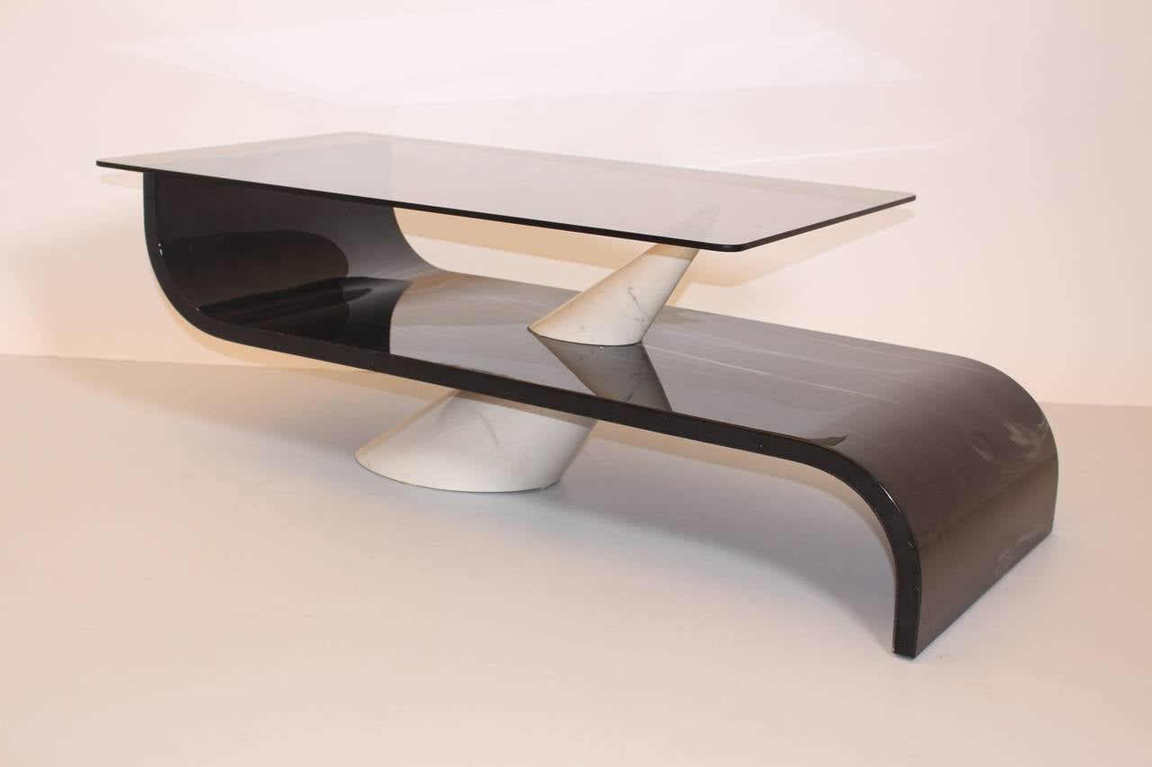 A mid century modern vintage dark grey and white coffee table, which was made of marbled glass. A ceramic cone features as base and as connection to the marbled glass. The coffee table was designed circa 1970 in Italy. While a glossy surface finish
