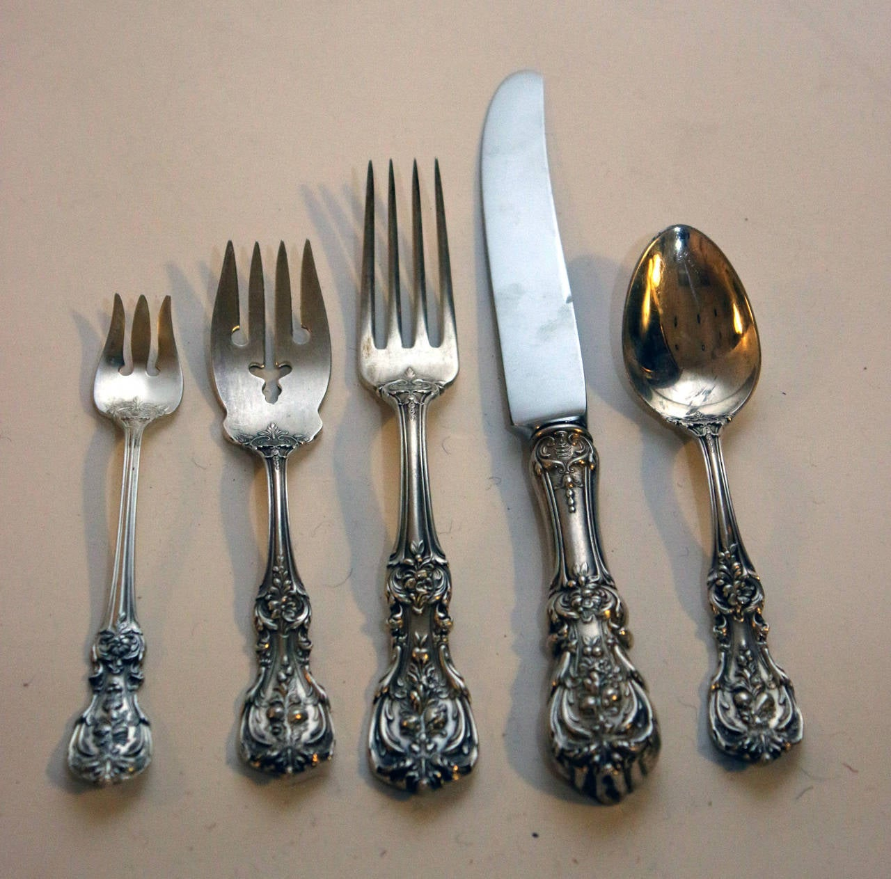 Classic set of Francis I was made by the prestigious firm of Reed and Barton silver company, Taunton, Mass. The sterling silver pattern was introduced in 1907,  (I have also seen idates of 1906 and 1908,) after the design work by Ernest Meyer. His
