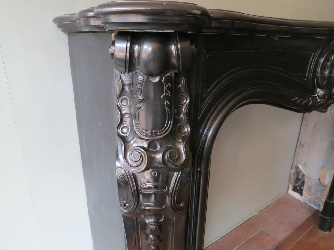 large antique french louis xv fireplace mantel in belgian black
