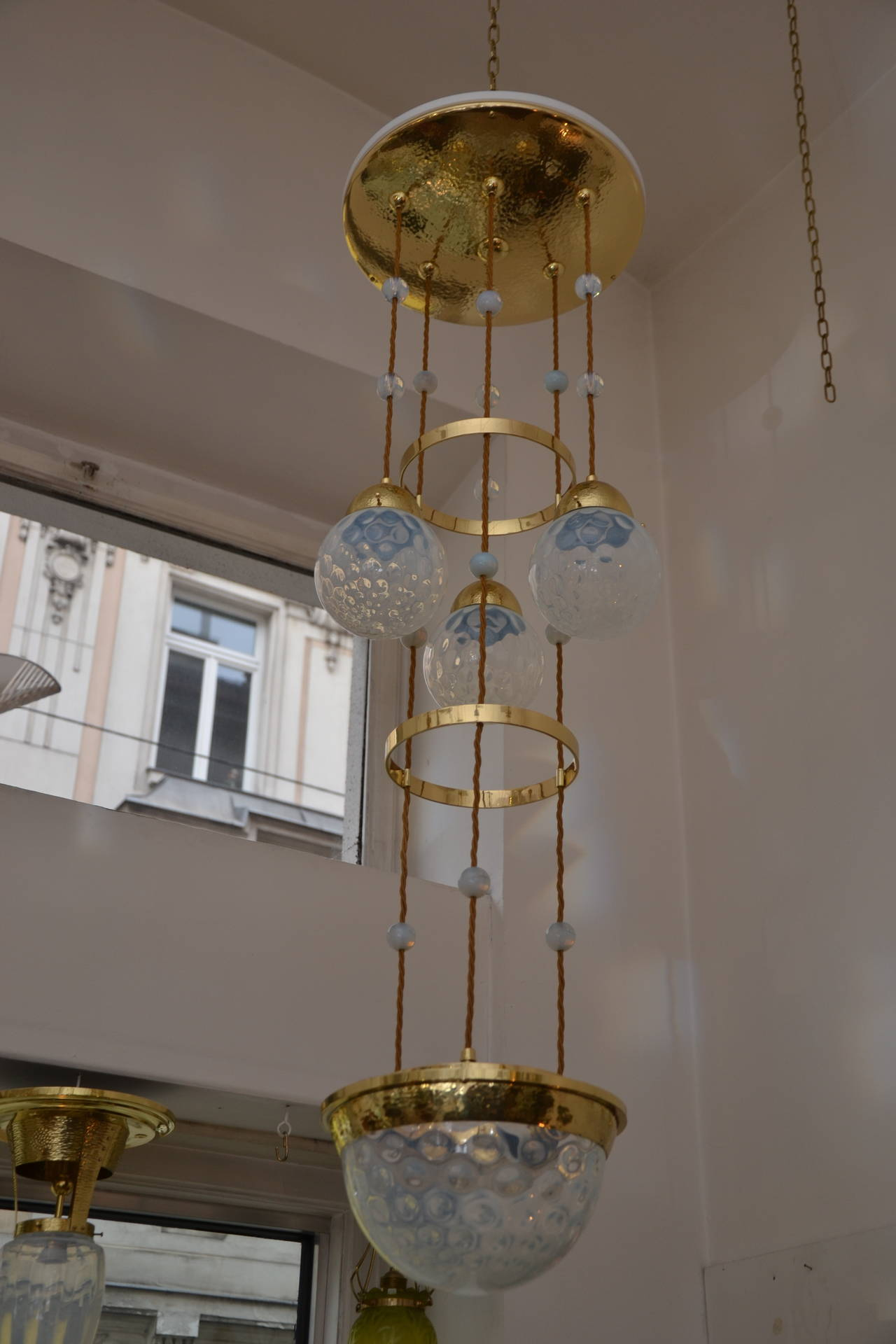 Koloman Moser attributed Bakalowits & Sohne chandelier hammered, with blue opaline glass lamp shades. The glass shades were obtained and from Bohemian glass manufacturers, amongst them also the renowned enterprise Johann Loetz-Witwe