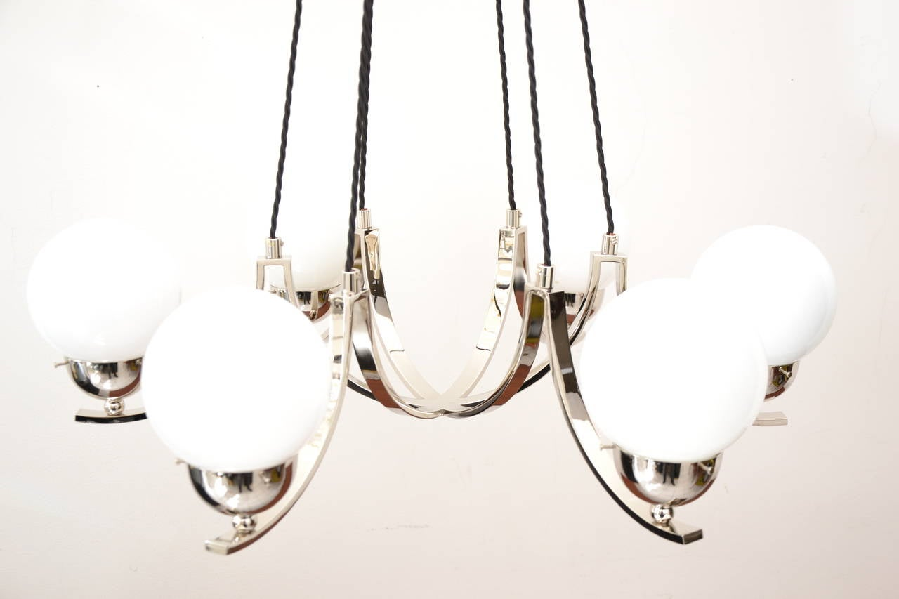 Impressive art-deco nickel-plated chandelier. Very large and decorative chandelier.