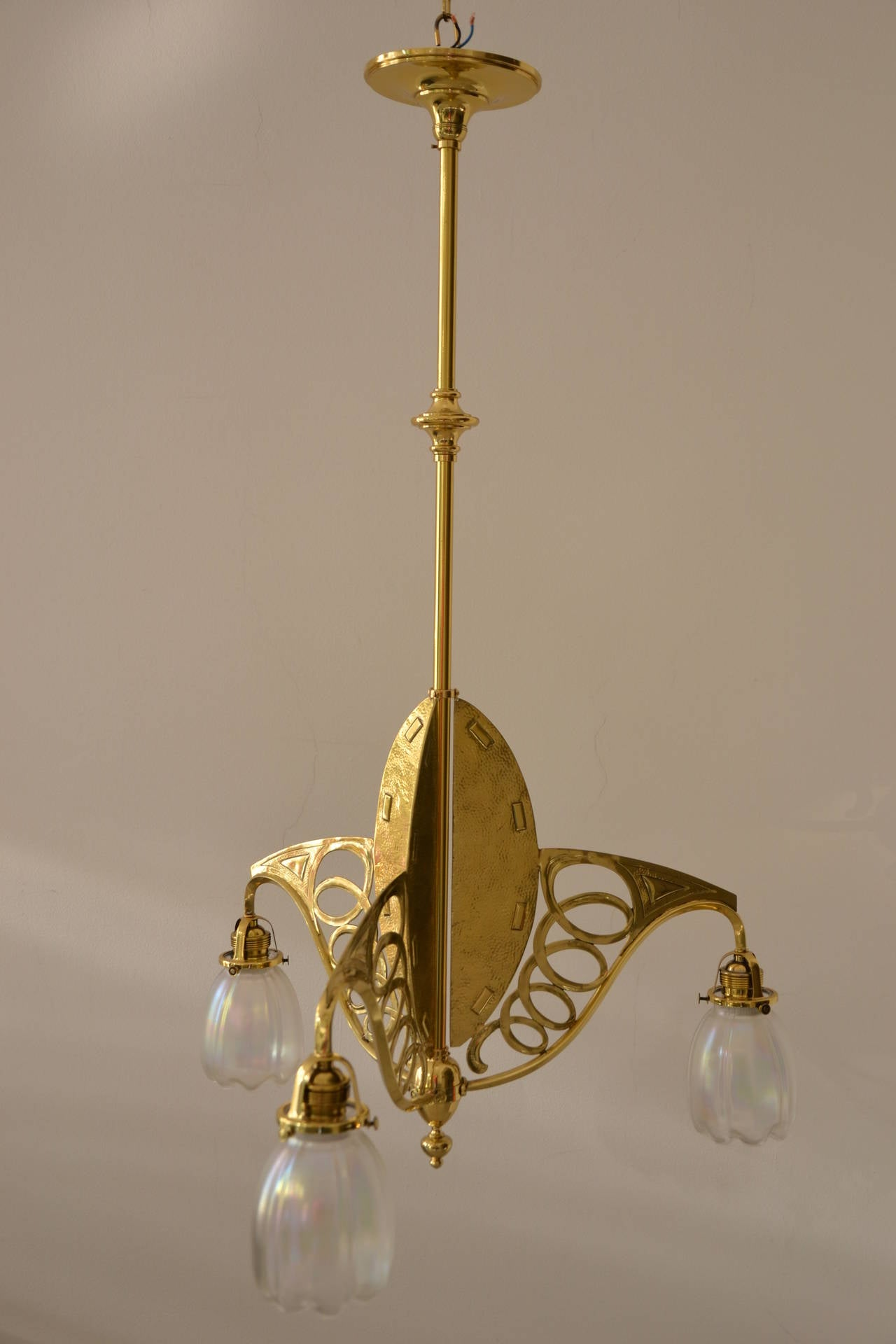 Art Nouveau three-light ceiling lamp brass partly hammered.