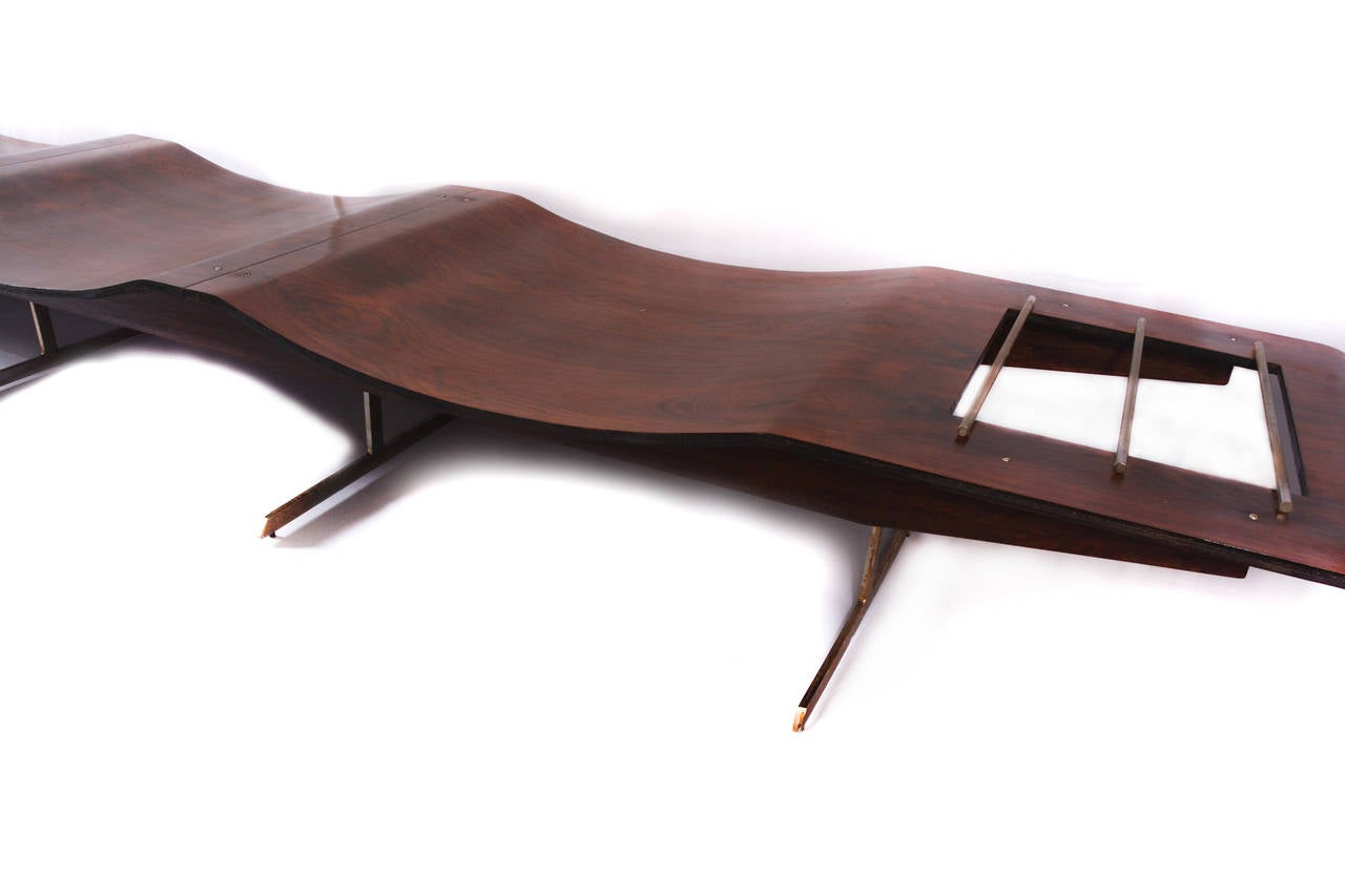 Rare Onda bench with three wavy seats in jacaranda with metal/wood legs and magazine rack of leather.