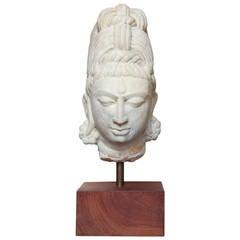 Carved stone head of Buddha