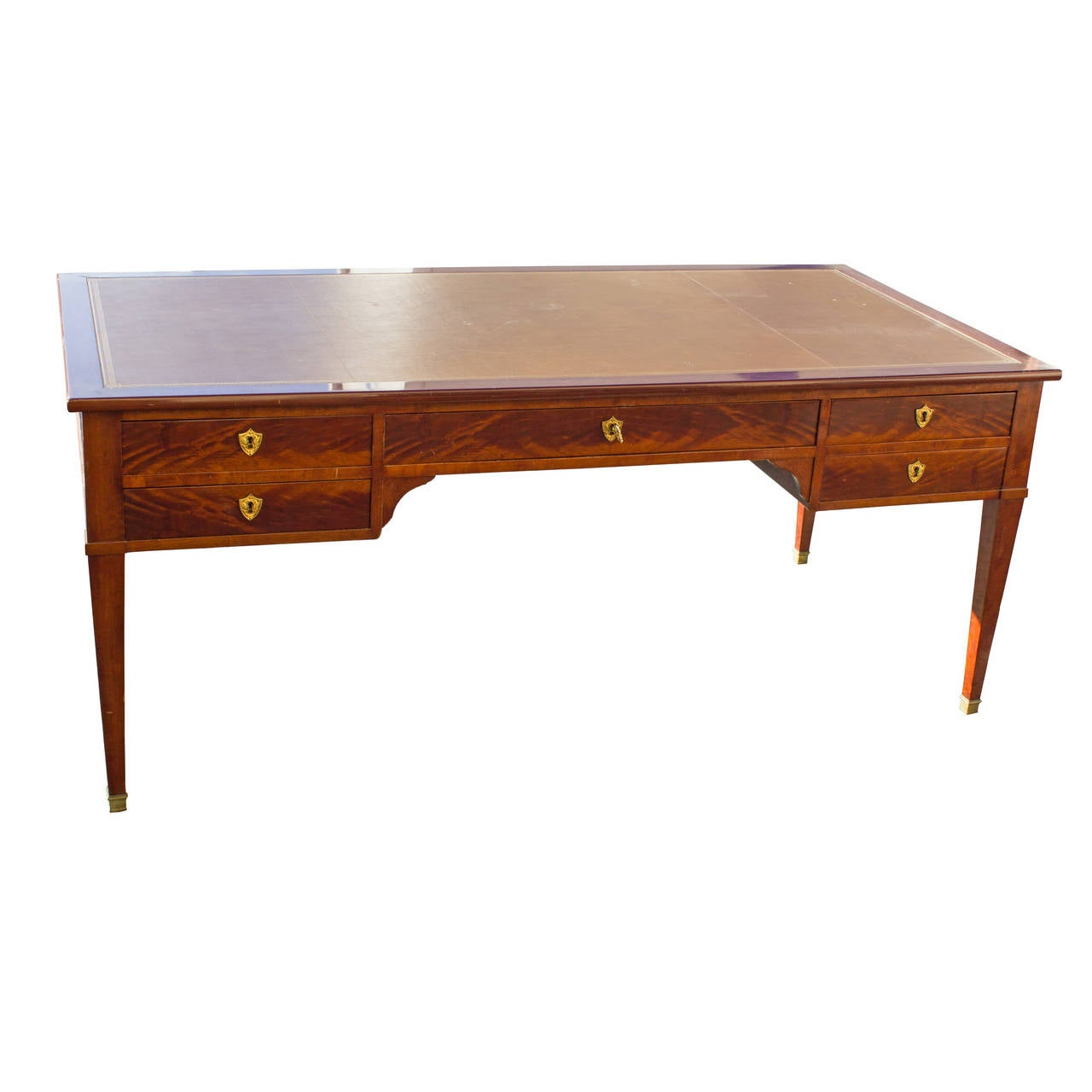 A Directoire style desk, circa 1940 with an inset leather top and brass hardware.