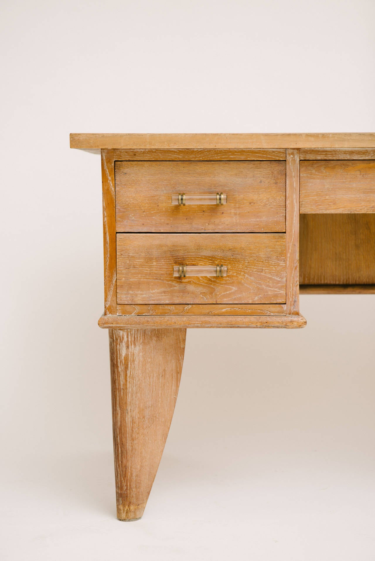 French Art Deco cerused oak desk with glass and bronze handles. Front opening for chair measures 14.5 inches wide.