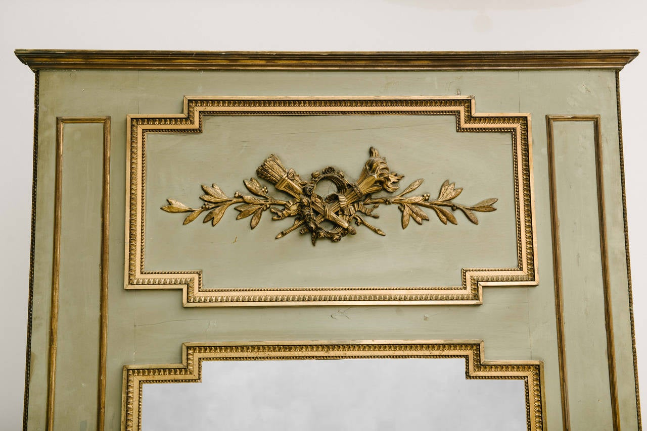 19th century French Louis XVI style painted and giltwood Trumeau.  Measures: 83.5